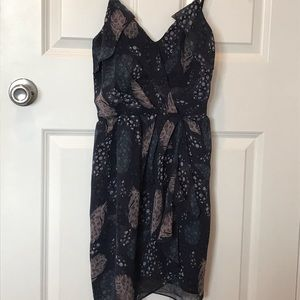Navy blue slip dress with feather motif design.